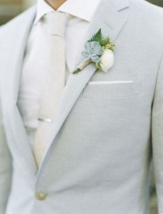 30 light grey suit with a cream tie and shirt, a succulent boutonniere - Weddingomania