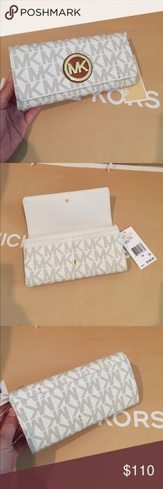 🌷Michael Kors Fulton Carryall wallet🌸🌴 💐🌹100% Authentic Michael Kors Fulton Carryall Vanilla💐 Add a little luxury to your everyday accessory repertoire with this sleek and slim wallet, crafted in the signature logo-print jacquard. This piece is as spacious as it is stylish, designed to keep your essentials safe and secure. With an oversized, gilded logo charm, you will strike a glamorous note as you move from work to play.   Specifications MaterialMK Signature PVC ClosureSnap closure…