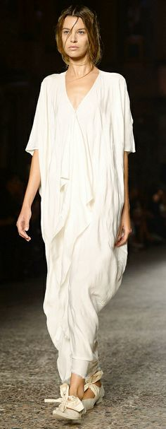 Uma Wang Spring 2014 | Milan Fashion Week | Get an austere head-to-toe white look with a sadhu-style draped dress, comfortable flats and wet hair. Don't wear any accessories to keep things bare
