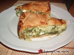 A delicious Greek filo pastry spinach pie recipe - spanakopita recipe. Famous Greek spanakopita stuffed with spinach, feta cheese, onions, pepper and herbs Pita Recipes, Greek Recipes, Gourmet Recipes, Cooking Recipes, Healthy Recipes, Greek Spinach Pie, Spinach And Cheese, Spanakopita Recipe, Greek Appetizers