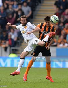 Juan Mata of Manchester United and Robbie Brady of Hull City compete for the ball