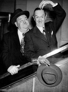 World famous film comedians Stan Laurel and Oliver Hardy are even comics when travelling, Here they are seen on arrival on the SS Queen Mary at Southampton this from New York, 1952