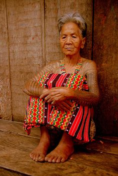 Kalinga woman with batek (tribal tattoos) in Luzon, Philippines by Rudi Roels