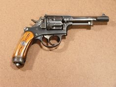 Swiss Ordnance Revolver, Model of 1882. This beautifully made, double action revolver fires a 7.5x23mm rimmed cartridge