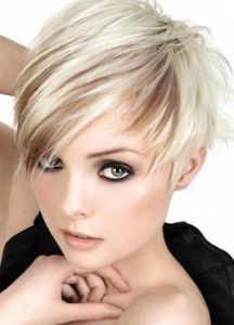platinum blonde hair with brown peak a boo highlight and a pixie asymmetrical haircut love the cut & color