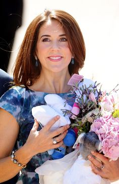 dailytelegraph:  Princess Mary happily accepted flowers from well wishers at the Sydney Opera House. Picture: Cameron Richardson
