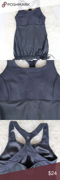 "Athleta Skills & Drills Striped Drawstring Tank XS Athleta ""Skills and Drills"" Gray/Charcoal Striped Tank Top. Has supportive built-in bra, and cute drawstring around hem. Soft, quality material as expected from Athleta.   Size XS  In good pre-owned condition, shows some signs of wear. Tag is split as pictured. No holes or stains, non-smoking home.   Open to reasonable offers in my closet, thank you for taking the time to view this item <3 Athleta Tops Tank Tops"