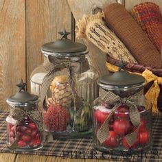 """<p>Large Black Star Glass Jar from Park Designs.Jars featurea black starknob on a metal lidwith ahomespunfabric tie. Can be filled with food or used for decor. Large -9"""" high (shown center back), Medium - 7"""" high, Small 5 1/2"""" high,sold separately.</p>"""