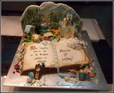 Awesome open book cake - by SabzCakes with illustrations as 3D decorations