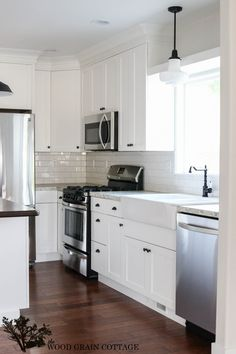 Small White Cottage Kitchen this kitchen - seriously - incredible. the white subway tile all