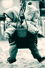 Two babies sharing a swing, so adorable   #playground #photography #blackandwhite
