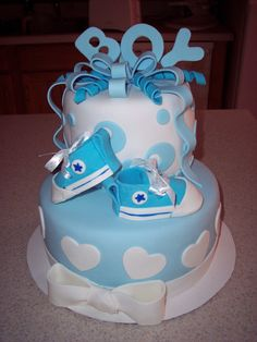 Baby Shower Cake, Boy - I made this for a friend who was hosting a baby shower.  Cake is red velvet with chocolate butter cream frosting.  All decorations are MMF.  I shamelessly copied the shoes from pic's I saw on CC. (Thank You!)
