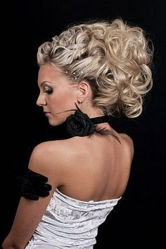 Blonde with collected curls and on the neck of the large black flower #hot #sexy #hairstyles #hairstyle #hair #long #short #medium #buns #bun #updo #braids #bang #greek #braided #blond #asian #wedding #style #modern #haircut #bridal #mullet #funky #curly #formal #sedu #bride #beach #celebrity #simple #black #trend #bob #girls