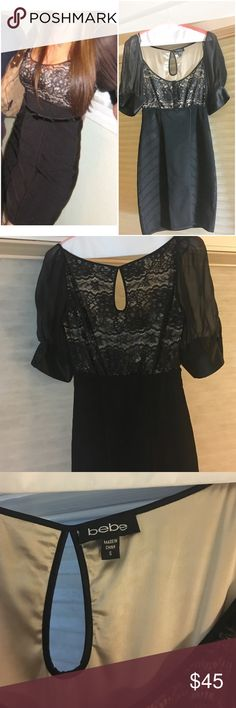 Bebe bodycon lace black dress Mini bodycon black Bebe dress. Top with nude lace and intricate button detailing. Tight bodycon skirt. Super cute for holiday parties or cocktail attire. Wore only twice. Excellent condition, like new. Has been dry cleaned and steamed. bebe Dresses Mini