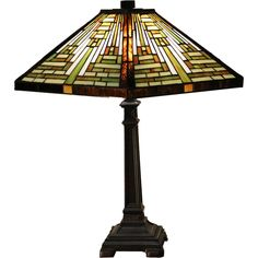 Decorate in the traditional craftsman style with this Tiffany-style table lamp. The shade features green, white and brown handmade stained glasses cut in a rectangular shape, and the base is slender a