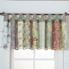 Wildflowers in Spring Valance- A beautiful floral patchwork of rosy pink, cornflower blue, straw yellow and mint green. Add the matching quilt and shower curtain to complete the look.