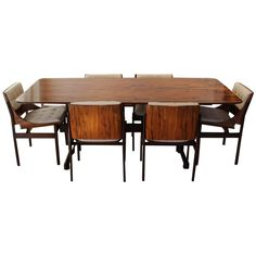 Brazilian Jacaranda Dining Room Set Attributed to Jorge Zalszupin | From a unique collection of antique and modern dining room sets at https://www.1stdibs.com/furniture/tables/dining-room-sets/