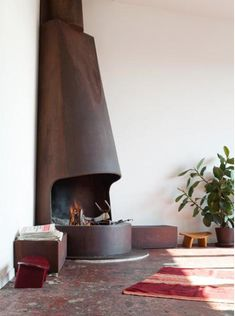 fireplace that I love but I think it would look better outside as a pit :)