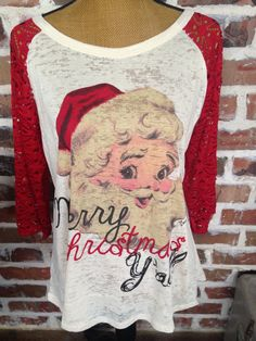 This was our best selling Christmas shirt last year! The Santa head is so cute…