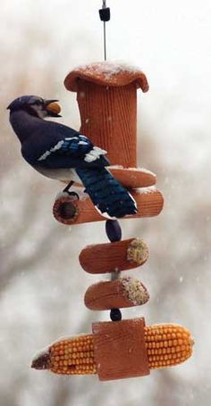 Handcrafted from weatherproof stoneware, natural bamboo and recycled glass beads, our Suet Feeders will entice birds to visit that may not go to seed feeders. Each design will create quite a stir in your backyard wonderland. More than just a suet feeder, the Pippin Suet Feeder had us laughing out loud. With a cache for peanuts, a place for corn or fruit slices, & plenty of room for suet, this feeder was taken for a spin by Blue Jays, Chickadees, and Woodpeckers.