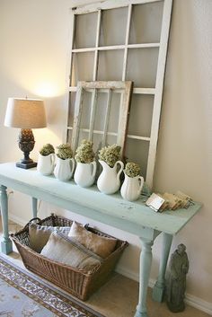 The Farmhouse Porch: Entry Way Refresh- plenty of old windows to use, use white pitchers and vases from wedding decor
