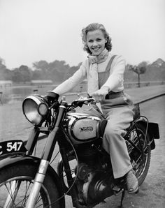 An poster sized print, approx (other products available) - 23 year old London-born film actress Honor Blackman riding her Norton Big Four motorcycle through Hyde Park in London. - Image supplied by PA Images - Poster printed in the USA Moto Norton, Norton Motorcycle, Girl Motorcycle, Girl Bike, Motorcycle Posters, Motorcycle Design, Classic Motorcycle, Scooter Girl, Motorcycle Quotes