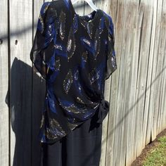 Vintage Evening Wear Black dress with shear top over that has gold and royal blue foiled leaves. Back has intricate covered buttons over the zippered area.  Worn once for a Christmas party. Lots of compliments!  Like new.  Dry clean.  This would also be cute for PROM coming up! Dresses Midi