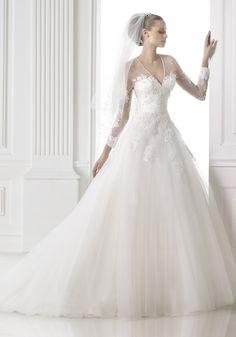 Pronovias 2015 Collection - V-neck neckline wedding dress.  Available at Designer Bridal Room