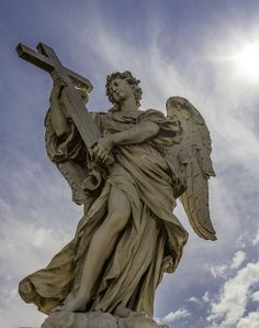 This is one of the ten angels designed by Bernini which flank the Ponte Sant'Angelo in Rome.