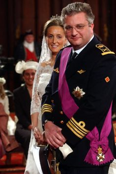 Prince Laurent and Princess Claire of BelgiumPrince Laurent of Belgium wed his beautiful bride Claire Coombs in front of 1,500 guests at Saint Michael and Gudula Cathedral on April 12, 2003. Their official union took place in a civil ceremony at Brussel's Town Hall prior to the elegant affair. Princess Claire wore a stunning gown by Belgian designer Edouard Vermeulen and a lace-edged veil worn by three generations of Belgian royalty.