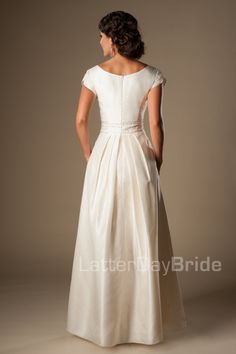 This stunningly cheap modest wedding dress features a flattering ruched bodice cinched by a wide beaded belt and completed by a pleated skirt and rich taffeta fabric. Gown available in Dark Ivory/Silver (as pictured), Ivory/Silver or White/Silver. Modest Wedding Dresses, Wedding Dress Styles, Bridal Dresses, Gown Wedding, Lace Wedding, Wedding Pins, Casual Wedding, Temple Dress, Evening Dresses Plus Size