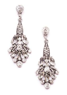 A gorgeous mix of transparent and opaque white crystals of varying sizes, these Winter Wonderland earrings are your very own unique snowflake. Team them with something strapless to show off their beauty to the fullest. Boutique Design, Braid Accessories, Green Chandeliers, Fantasy Jewelry, Delicate Rings, Bridal Beauty, Chandelier Earrings, Modern Jewelry, Statement Jewelry