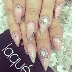 Stiletto nails, gorgeous nude/blush colored nails with white accent details and lots of bling! laquenailbar's photo on Instagram