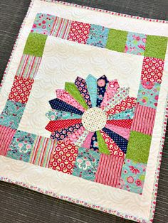 Free Baby Quilt Pattern: Dresden Window Pane Tutorial featuring Flutterberry fabric designed by Melly & Me for Riley Blake Designs #iloverileyblake #rileyblakedesigns #mellyandme #flutterberry