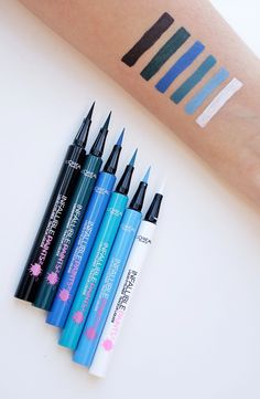 Swatches of the new Infallible Paints colored L'oreal liquid eyeliner. Precise fine tip application in bold shades of blue, green, teal, black and white. Makeup Swatches, Drugstore Makeup, Makeup Cosmetics, Blue Eyeliner, Eyeliner Pencil, Liquid Liner, Mac Eyeliner, Eyeliner Tattoo, Makeup Organization