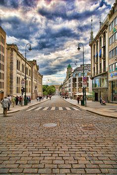 karl johans gate (the main street in Oslo) and stortinget building to the left (parliament building), Oslo