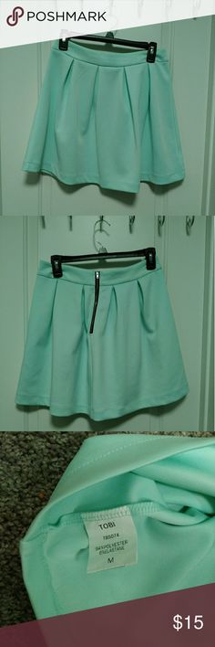 Tobi Light Blue Scuba Skirt Like new. Worn once. Light blue with black zipper detail on the back. Very cute with a crop top! Tobi Skirts
