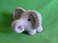 This baby elephant was crocheted using a free Lion Brand pattern. I like that the trunk was left flat and curled under a bit. I think it looks cuter than having a stuffed cylindrical trunk. This is a good example of taking a free pattern and making it your own. When I looked at the elephant close up, it appears to be made with a marl yarn or a novelty yarn with a sparkly strand woven in – a nice touch that makes him even more special.