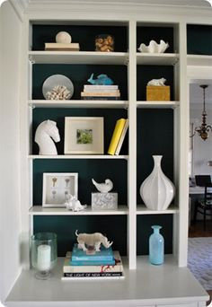 6.t's OK to be Single.   Smaller cubbies look simply perfect with a textured or sculptural object placed all by itself.  Notice the use of a single vase or shell in the smaller spaces of John & Sherry's bookcase, and the fantastic contrast with bold blue and crisp white.  yhl painted built in