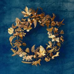 Inspired by Victorian-era holiday décor, 'Dresden ornament' wreaths were first crafted in Germany using antique candy molds. Made especially for terrain by Rhode Island artist Julie Munafo, each wreath is ringed with brass figurines that represent celebrations throughout the year, mingled with delicate flora and fauna. Spaces in the three-dimensional shape allow fresh foliage and blooms to be tucked between the figurines as the seasons change. Produced from the 1890s onward, vintage Dresden…