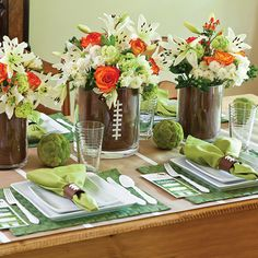 This football party tablescape was created with ease and convenience in mind. It's cleverly built around everyday dishes and glassware and crowd-pleasing decorations. A neutral color palette of brown, green, and white works for any team.   Two different-sized glass cylinders, one inside the other, make up the centerpieces. Scrapbook paper trimmed to size fills the space between the