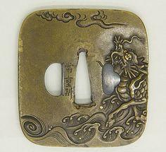 Sword guard (tsuba)  Kawamura Tsuneshige, active late 18th century     Date:      late 18th century  Culture:      Japanese  Medium:      Brass, gold, silver, and shakudo  Dimensions:      7.1 x 6.6 cm  Classification:      Sword Furniture
