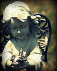 This photo of an angel holding a baby bird was taken at Mount Calvary Cemetery in Steubenville, Ohio.  It is available now as an 8x10 print through my Etsy store.  Only $6, plus shipping and handling.