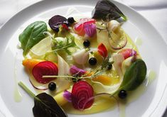 """3 Michelin starred L'Arpege, Paris. Chef Alain Passard presents """"la cuisine legumiere"""" focusing almost exclusively on game, seafood and vegetables."""