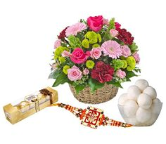 A perfect Rakhi combo for dearly brothers delighted with colorful Rakhi thread,small Ferrero Rocher box and sweets.  Buy & send to India online from IndianGiftsCenter.com