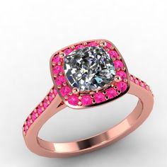 14K Rose Gold Pink Sapphire Engagement Ring with Moissanite Center   -Style 54RGPSME. $1,250.00, via Etsy.
