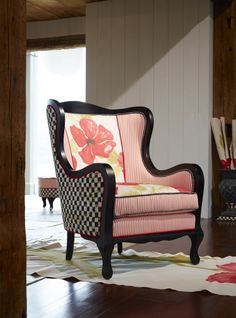 I really like this chair and the pop of color and whimsy of the checks of course.  For the poppy lover!