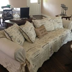 Refurbish old sofa. Slip cover, king size quilt, pillow shams and pillows...voila!