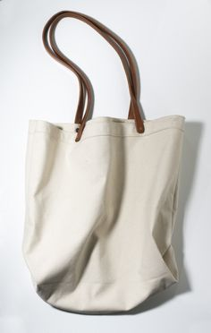 """cool canvas bag with leather straps from """"etwasbags"""":  DECK THE HALLS holiday market    until dec 22nd, 12 - 8pm    32 prince @ mott st,  nyc    or order them from will + ship them: studio@etwasbags.com    $50"""