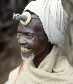 Africa | A Konso man wears a phallic Kallaacha on his forehead. Made of cast aluminium and ivory or bone, the Kallaacha is worn during the tribe's initiation and gada age-grade ceremonies. The Konso who live by their successful agricultural economy, live next door to the pastoral Borana and have many customs in common including the wearing of the phallus. Gamo Gofa Province, Konso, Ethiopia | © Nigel Pavitt / John Warburton-Lee
